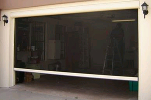 Rolls and retractables the screen doctor of lee county for Motorized roll up garage door screens