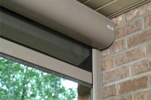 Electric roll screens the screen doctor of lee county for Storm door with roll up screen