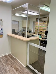 Sneeze guard and walkway partition installed at dentist's office on Del Prado Blvd